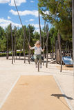 Little child swinging at urban park Royalty Free Stock Images