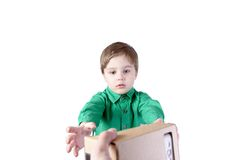 Little child takes virtual reality (VR cardboard)  on white background Stock Images