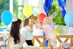 Little child and their mother celebrate birthday party with colorful decoration and cakes with colorful decoration and cake Royalty Free Stock Image