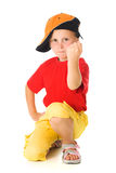 Little child threatens with a fist. On a white background Royalty Free Stock Photography