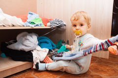 Little child throws clothes Royalty Free Stock Photo
