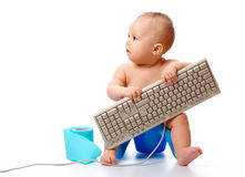 Little child is typing on keyboard Royalty Free Stock Photos