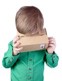 Little child uses virtual reality (VR cardboard)  on white background Stock Photography