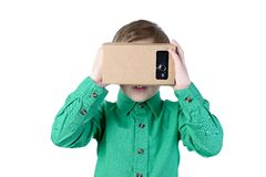 Little child uses virtual reality (VR cardboard)  on white background Stock Images