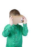 Little child uses virtual reality (VR cardboard)  on white background Stock Photo