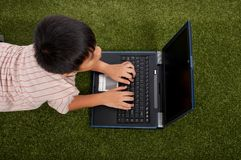 Little child using laptop Stock Photography