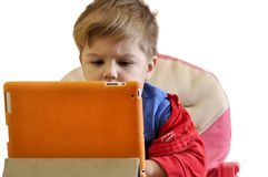Little child using a tablet PC isolated Royalty Free Stock Photography
