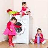 Little child using washing machine Stock Photo