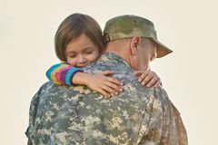Little child is very happy her father came back from army.