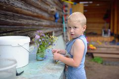Little child in village. Russian rural view Royalty Free Stock Photography