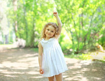 Little child walking in the park and showing up hand Royalty Free Stock Image