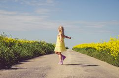 Little child walking in rural path in beautiful summer nature stock photo