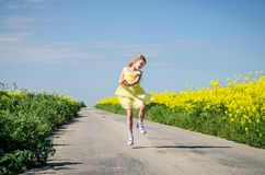 Little child walking in rural path in beautiful summer nature stock images