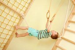 Little child walking on tightrope. Balance training. Stock Images