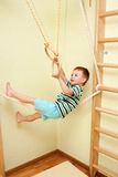 Little child walking on tightrope in the sports complex. Stock Image