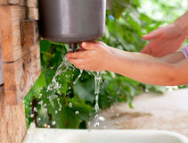 Little child washing hands. Little child washes his hands in the sink in the garden stock photos