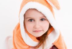 Shy little bunny girl in peachy robe Stock Image