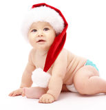 Little child wearing red Christmas cap Stock Photo