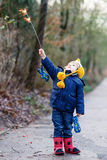 Little child in winter clothes holding burning sparkler Stock Photos