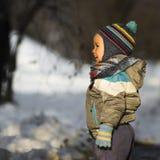 Little child at winter Stock Photos