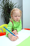 Little child writes pencil Royalty Free Stock Image