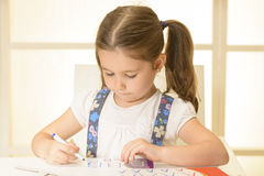 Little child writing letters Stock Image