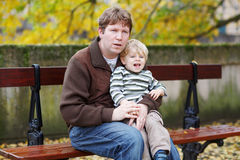 Little child and young father in autumn city Royalty Free Stock Photo