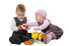 Little Children. Small children play. Isolated. White background Stock Photo