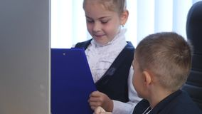 Little children as a businessmen, in office.  stock video footage