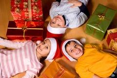 Little Children As Santa In Red Cap Stock Photo