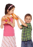 Little children with bagels Royalty Free Stock Photo