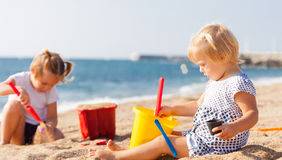 Little children on beach royalty free stock photo