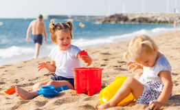 Little children  on beach Stock Image