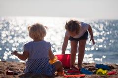 Little children  on beach Stock Photos