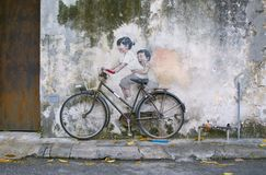 Sibling Cyclist Street Art Mural in Georgetown, Penang, Malaysia Stock Photos