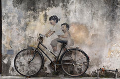 Little Children on a Bicycle street art mural by Lithuanian artist Ernest Zacharevic in Georgetown, Penang, Malaysia. royalty free stock photos