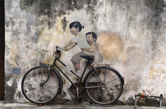 Little Children on a Bicycle street art mural by Lithuanian Stock Images