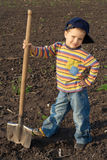 Little children with big shovel Royalty Free Stock Image