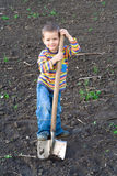 Little children with big shovel Royalty Free Stock Images