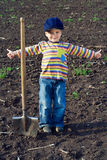 Little children with big shovel Royalty Free Stock Photos