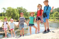 Little children with binoculars outdoors. Summer camp royalty free stock photography