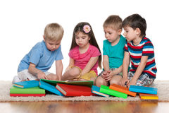 Little children with books on the floor Royalty Free Stock Image