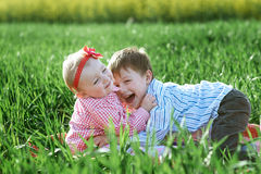 Little children boy and girl play on green grass Royalty Free Stock Image