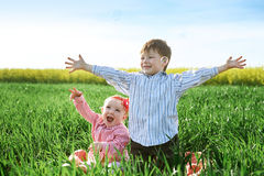 Little children boy and girl play on green grass Royalty Free Stock Images