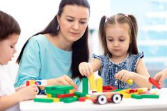 Little children building block toys at home or daycare. Kids playing with color blocks. Educational toys for preschool. Little children building block toys with royalty free stock image