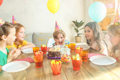 Little children celebrating birthday together at home Stock Photos