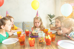 Little children celebrating birthday together at home Royalty Free Stock Images
