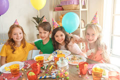 Little children celebrating birthday together at home Stock Photo