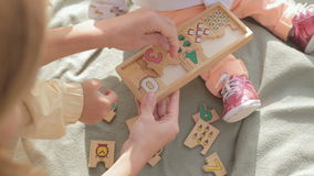 Little children collect wooden toy with numbers stock video footage