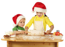 Little children cooking the Christmas cake Stock Image